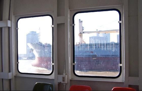 Ferry window and freighter