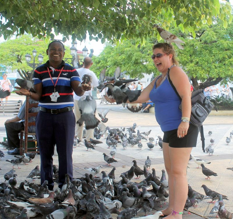 Lynde with a pigeon on her head (and hand) - Puerto Plata