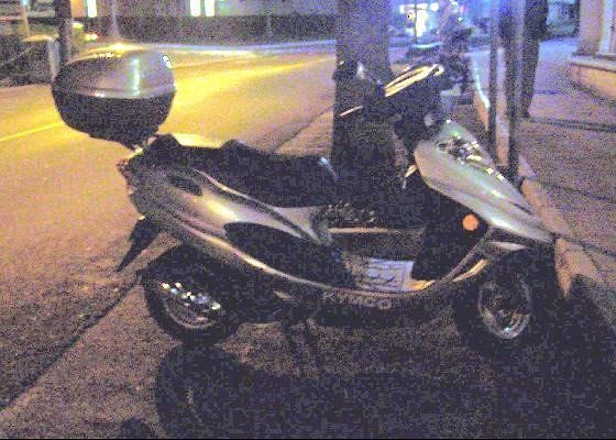 Motorscooter parked at night