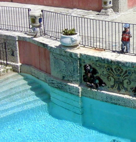 Little boy looking into the pool