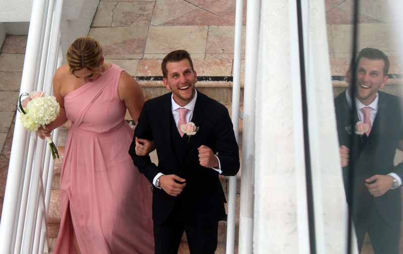 Granddaughter and groomsman recessional