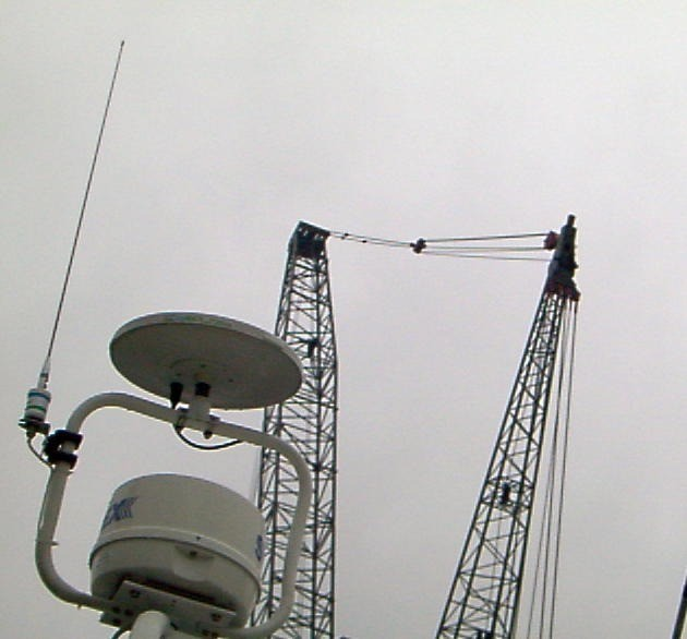 Our TV antenna and radar dome - cranes for the steel in the back