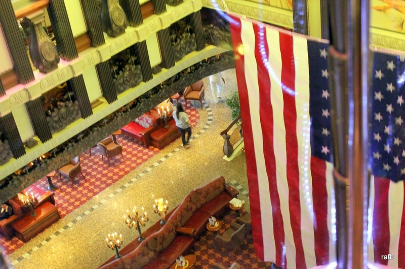 Flag in atrium for Veterans Day - from glass elevator