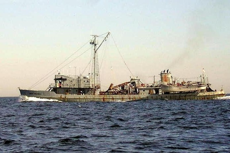 Large menhaden boat with net boats on the side davits
