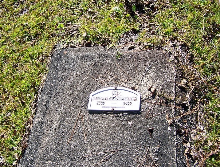 Concrete grave cover with funeral home marker to save money