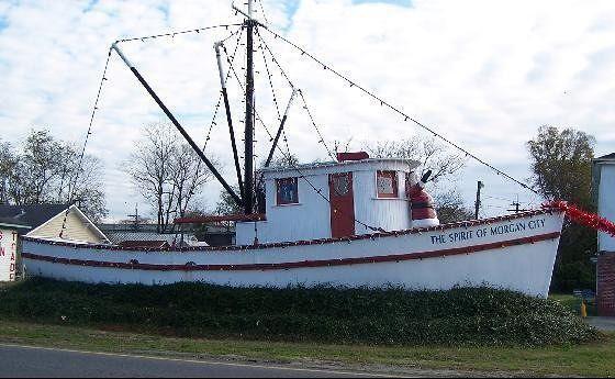 The Spirit of Morgan City-Santa at the helm