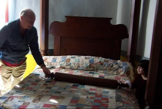 Bob 'rolling' the mattress with a little girl