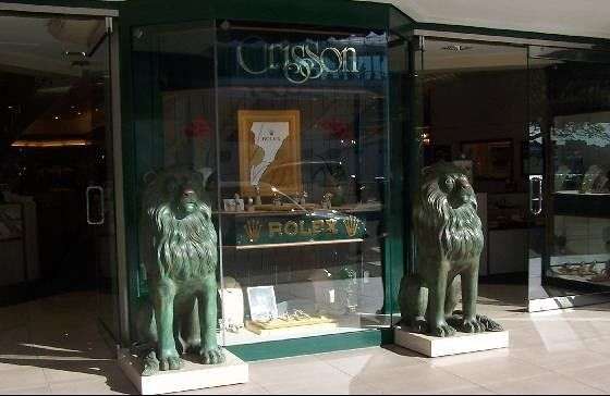 Crisson with lions guarding the Rolex watches