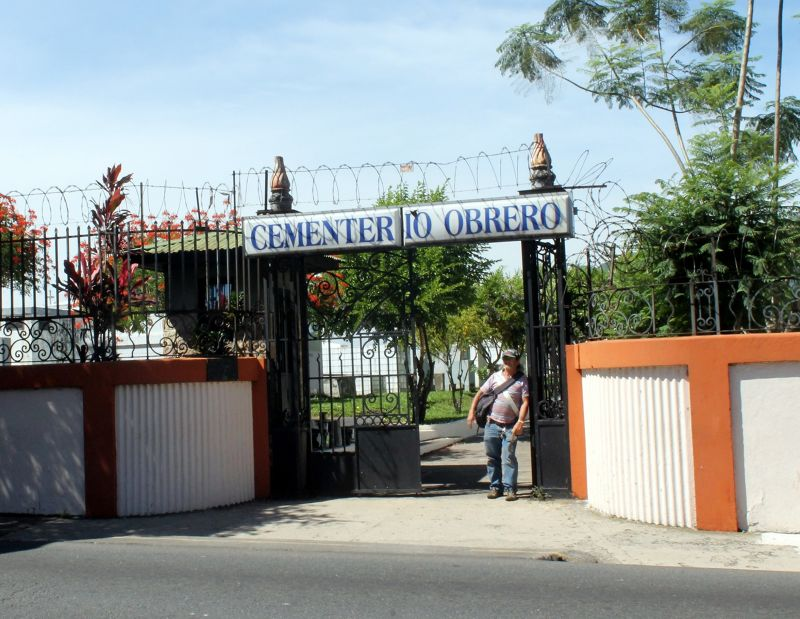 Obrero Cemetery gate with watchman