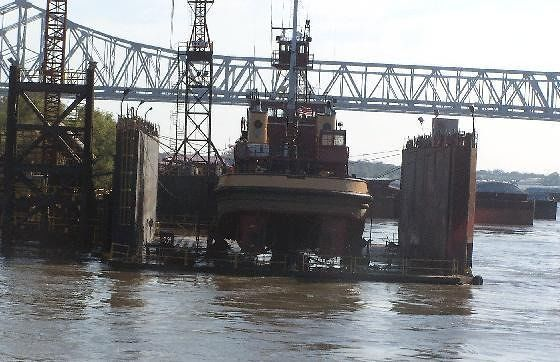 Boat in drydock - bridge in back