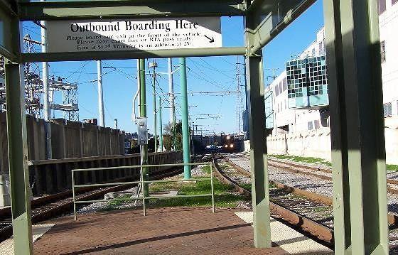 Train next to Streetcar Track