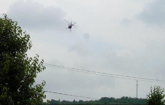Heliocopter flies over the town