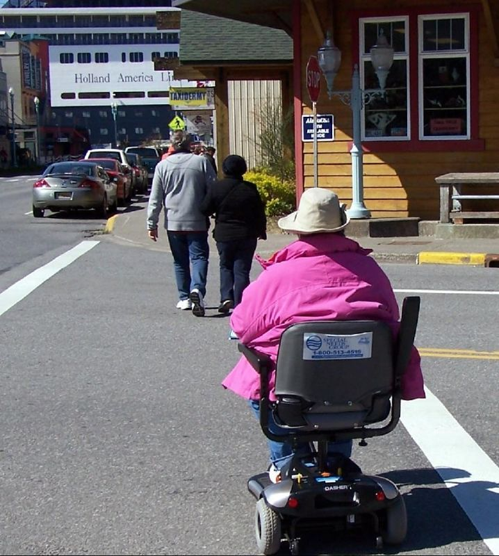 Bob's photo of me on the scooter -street crossing