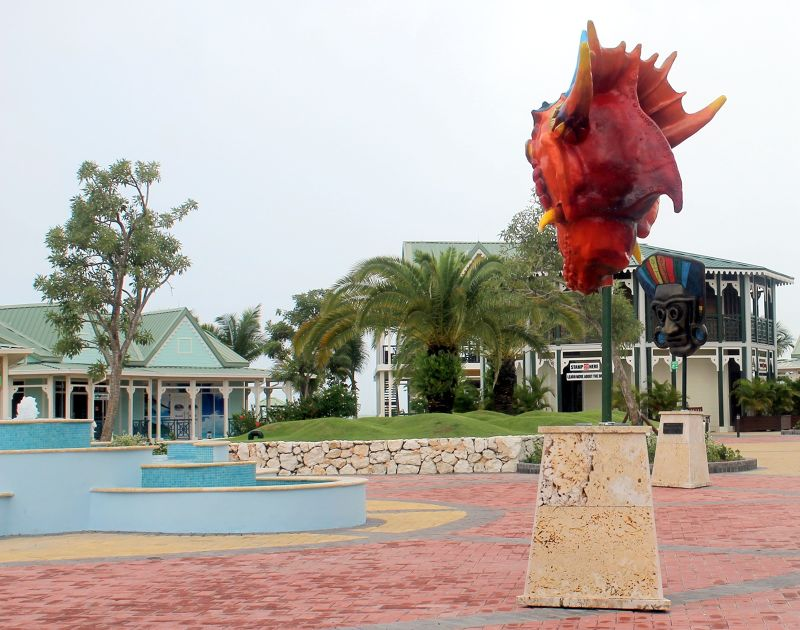 Jurassic Park dinosaur head in the shopping area - Amber Cove