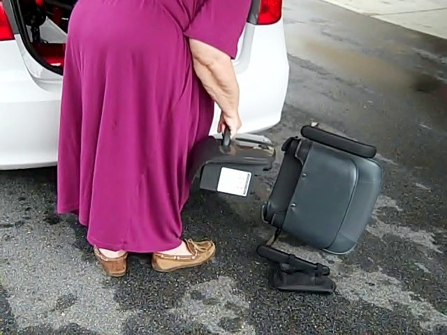Taking the battery out of the trunk
