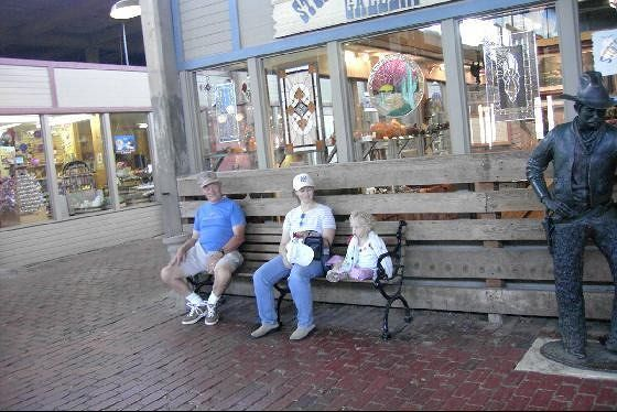 Bob, our daughter and granddaughter on a bench