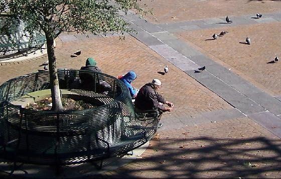 Homeless or Vagrants Huddled in the Sun