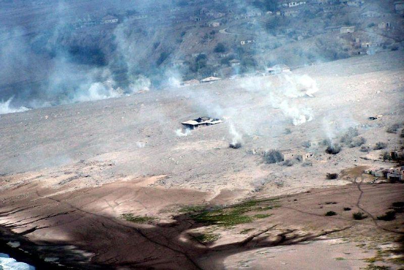 Smoke rising from burning buildings - Montserrat