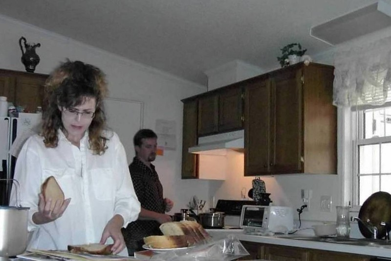Daughter-in-law and son in their kitchen