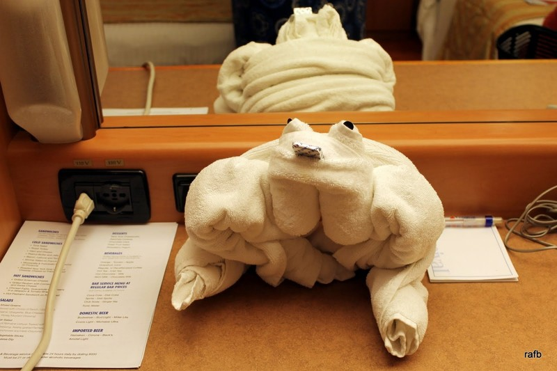 Towel animal frog with a mint in his mouth