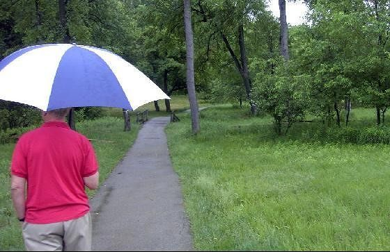 Bob walking out to the fort in the rain