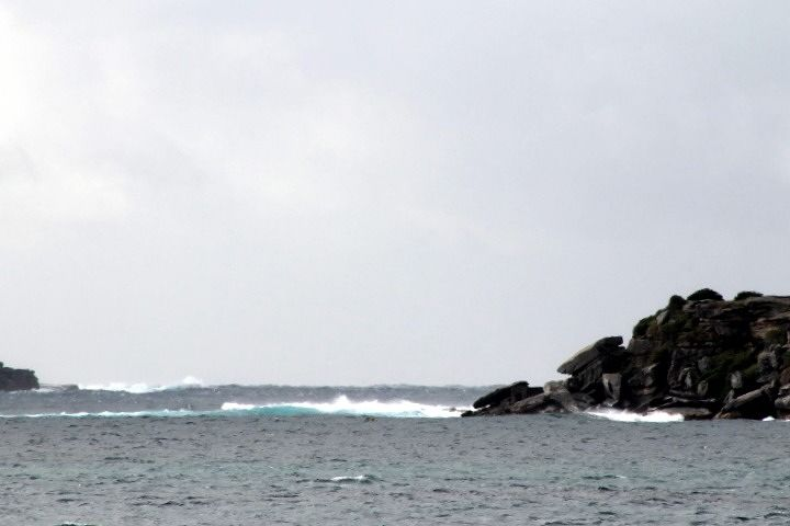 Surf at the harbor entrance