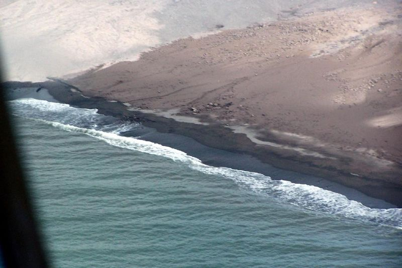 Black sand beach from the helicopter
