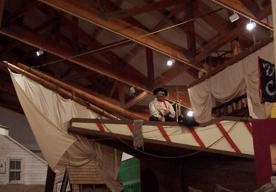 Sailor on the prow of a vessel inside the museum