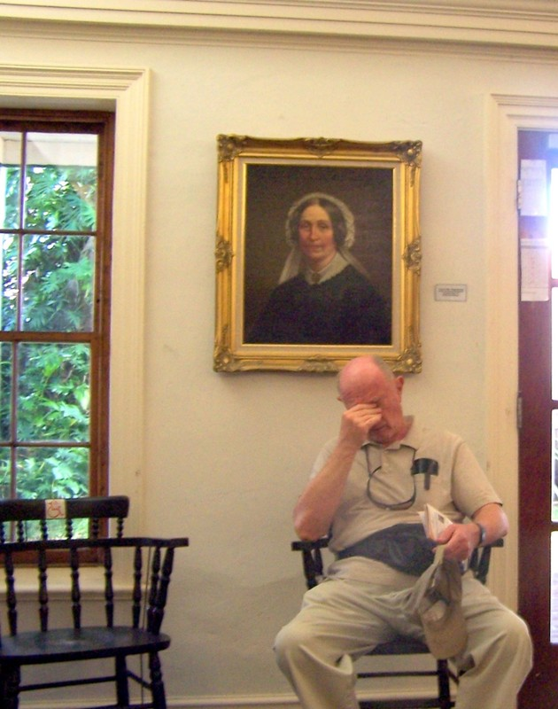 Bob sitting under Mrs. Perot's portrait