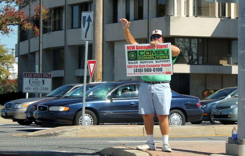 Man waving at traffic