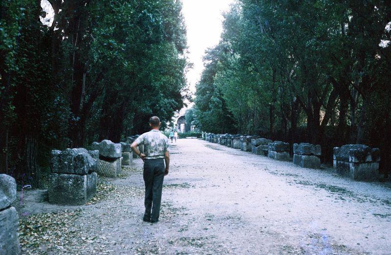 Bob walking between the tombs