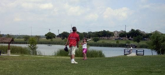 Warren center lake with children playing catch