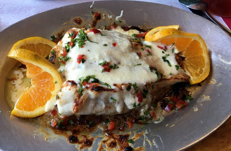 Rockfish stuffed with crab and topped with a creamy cheese sauce