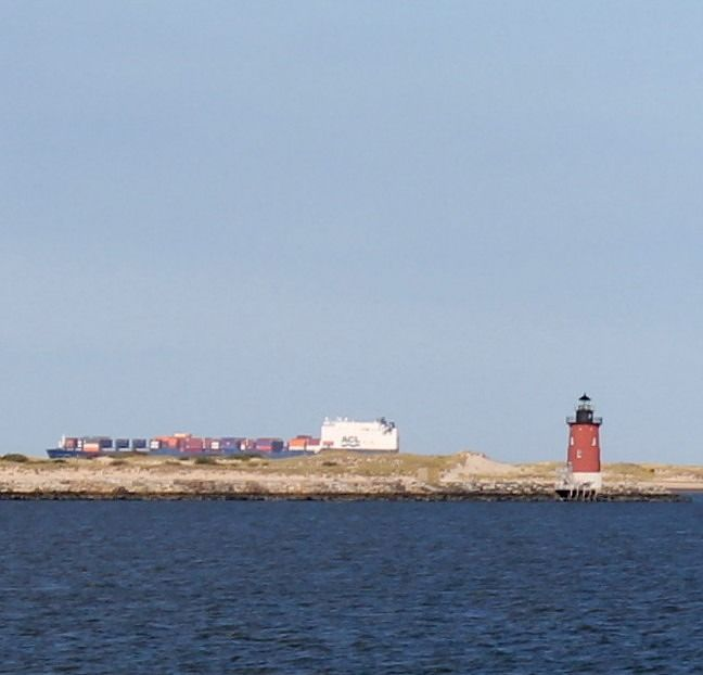 Lewes Breakwater Light  with a container ship on the other side