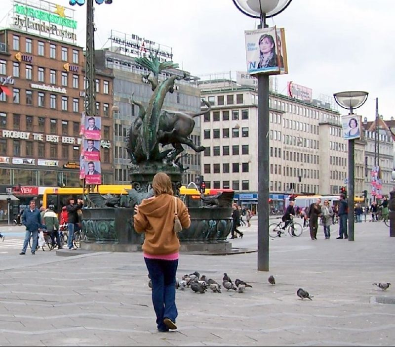 My granddaughte chasing pigeons in the Town Square