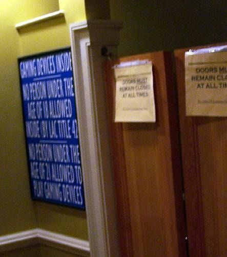 Signs on the Slot Machine Room Door