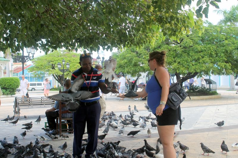 putting the food in her hand - Puerto Plata