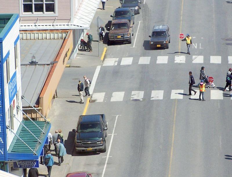 Traffic wardens let pedestrians cross