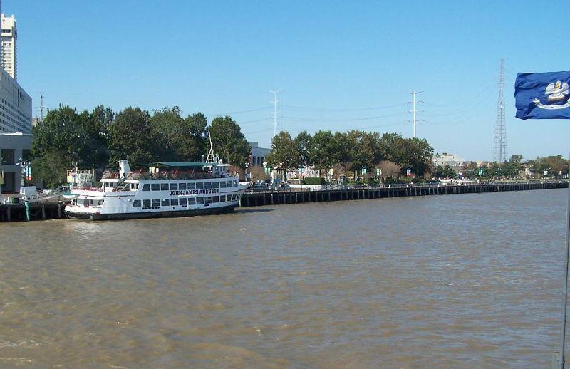 Louisiana flag on right