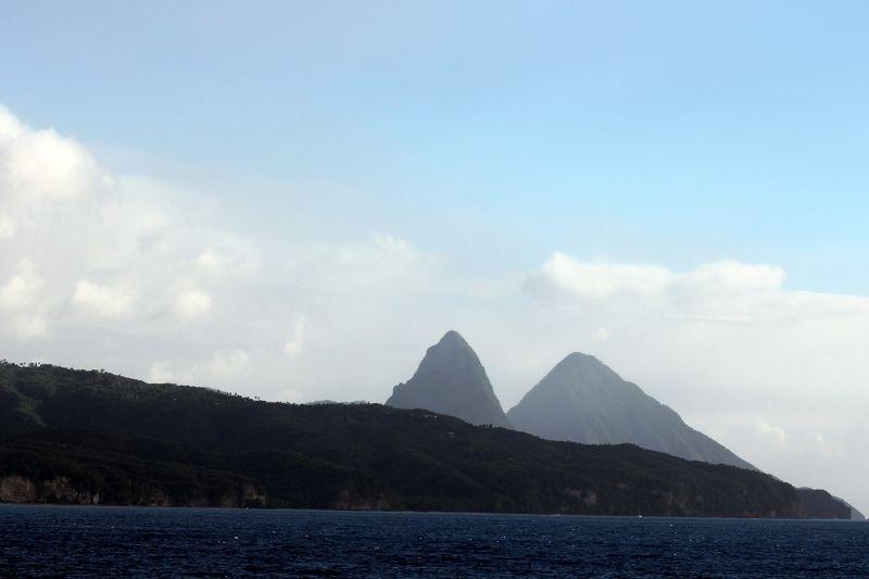 Peaks Peeking up over land