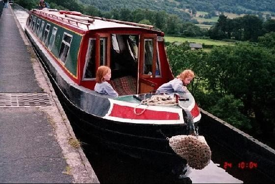 Twins on the bow of a narrow boat