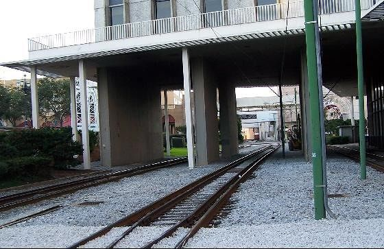 Tracks continue under a building
