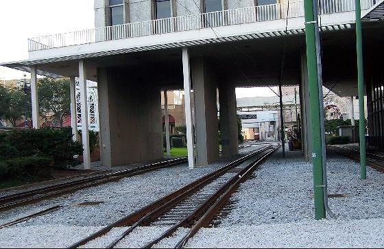 Tracks continue under a building