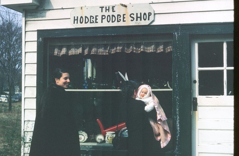 My, my mom and my child in front of the Hodge Podge Shop in 1962