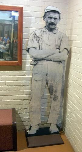 Cardboard cutout of a pottery worker