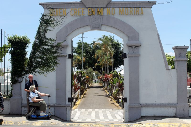 Gate of Desamparados Cemetery with Bob and me