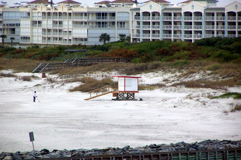 Metal detecting on the beach by closed life-guard stand