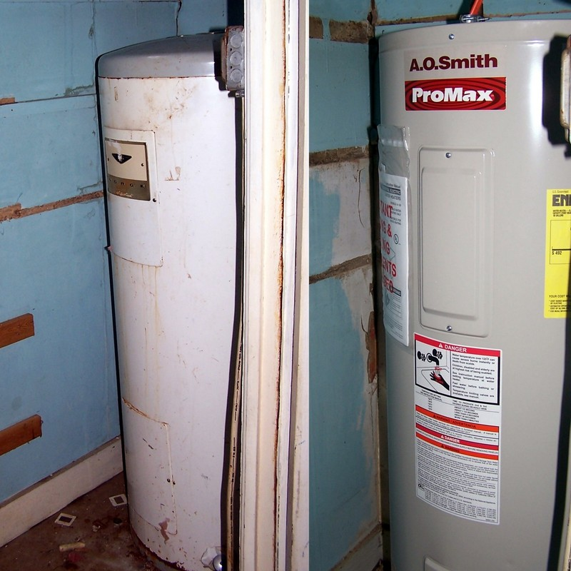 Left - old water heater that was here in 1973.  Right - new geothermal water heater