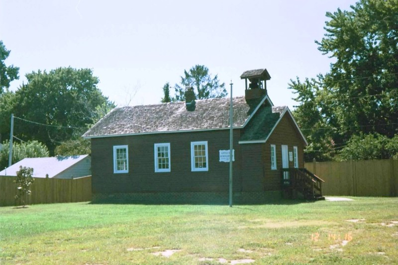 The Little Red Schoolhouse which is on the grounds of the museum