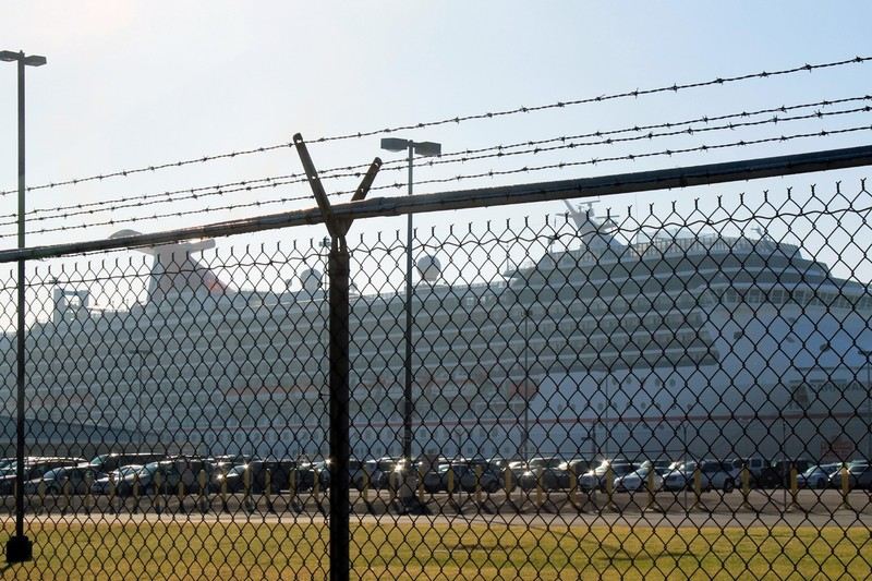 Carnival Pride through the chain link fence